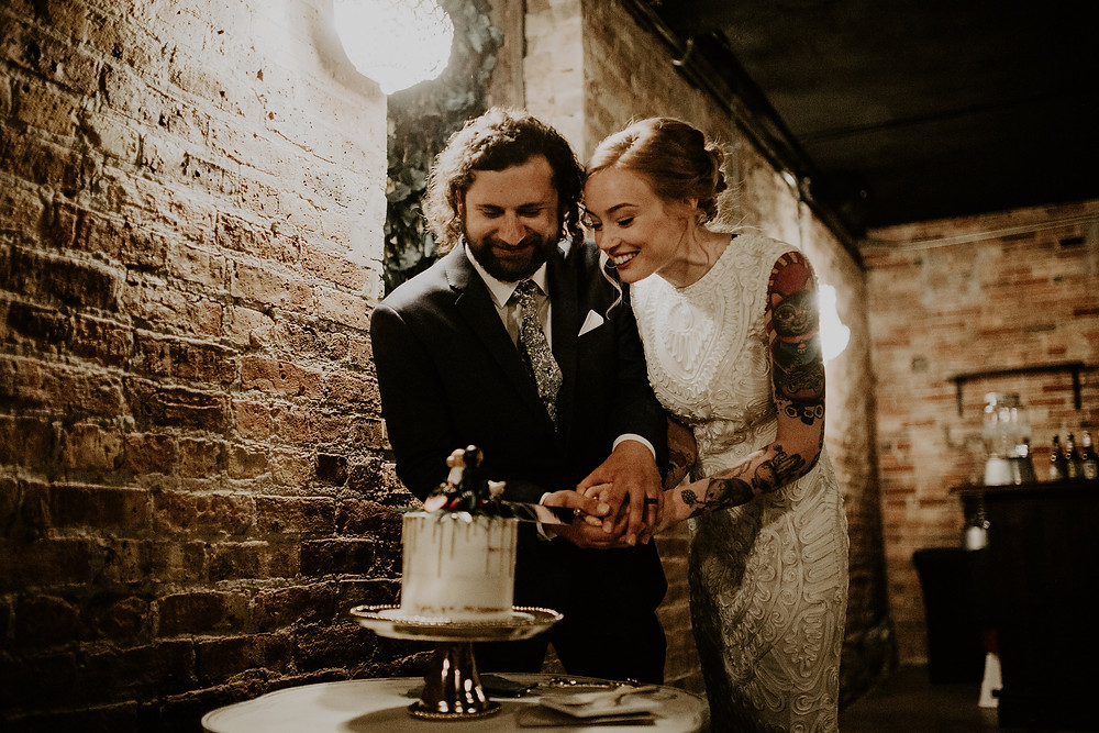 The bride and groom were excited to share their wedding cake with guests