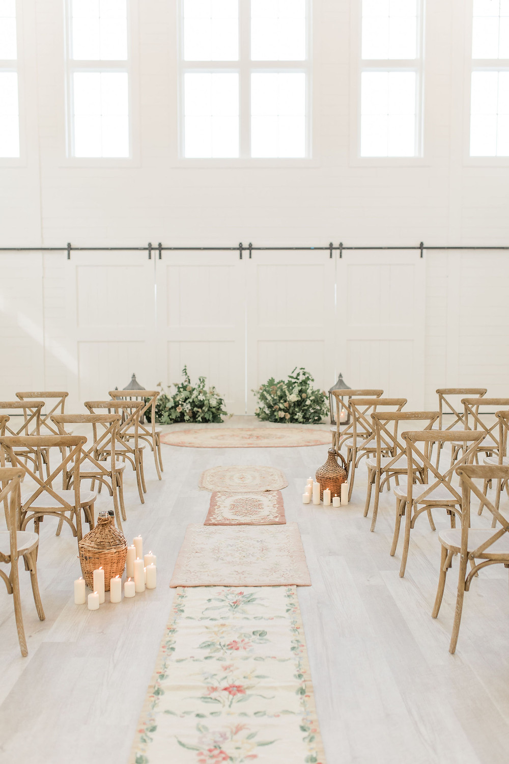An aisle runner of vintage hooked rugs carried through the color palette for this vineyard wedding.