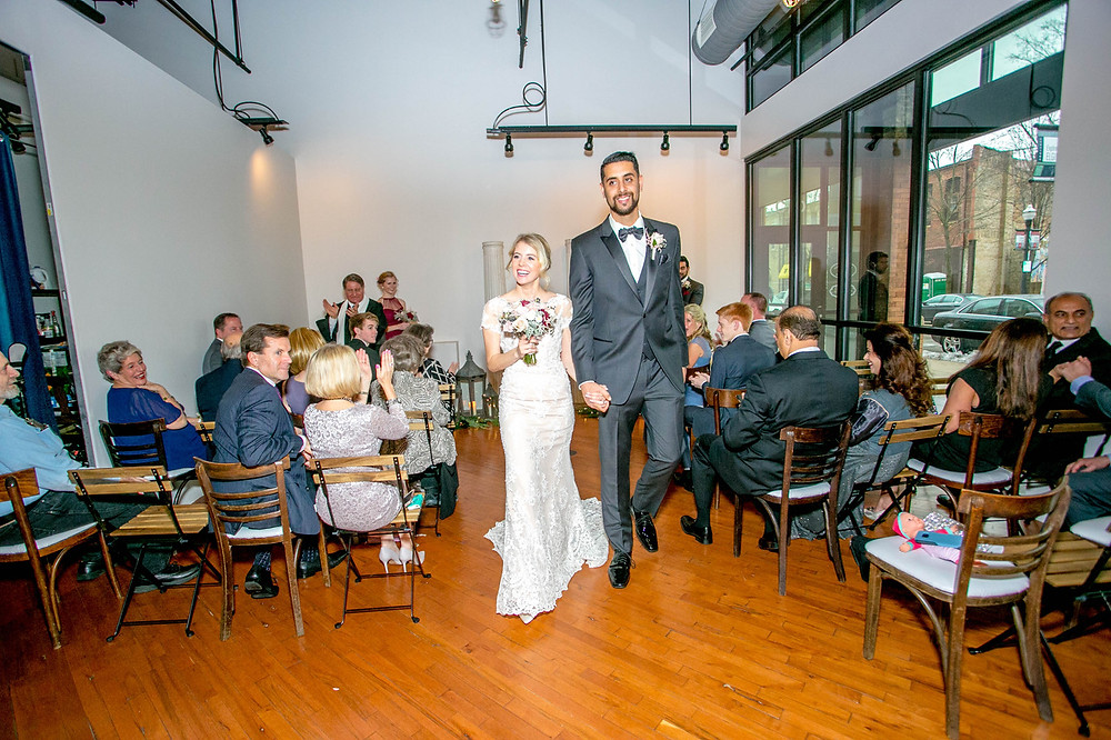 bride and groom recessional following tiny elopement wedding at Loft of Elements Preserved in Elgin, IL