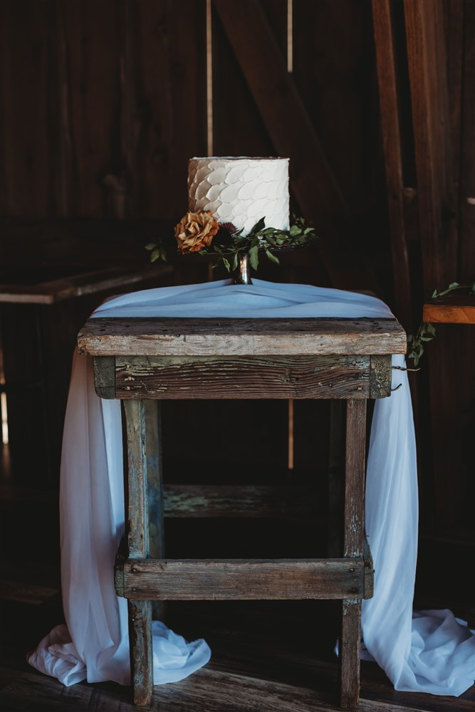 farm table for wedding cake; prairie style farm table; vintage rentals; rustic event rentals