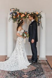 bride-groom-ceremony-vintage-rug-pillars