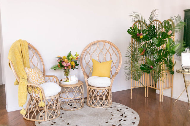 Providing a seating area with wicker chairs and bright yellow pillows was a perfect addition to the decor.