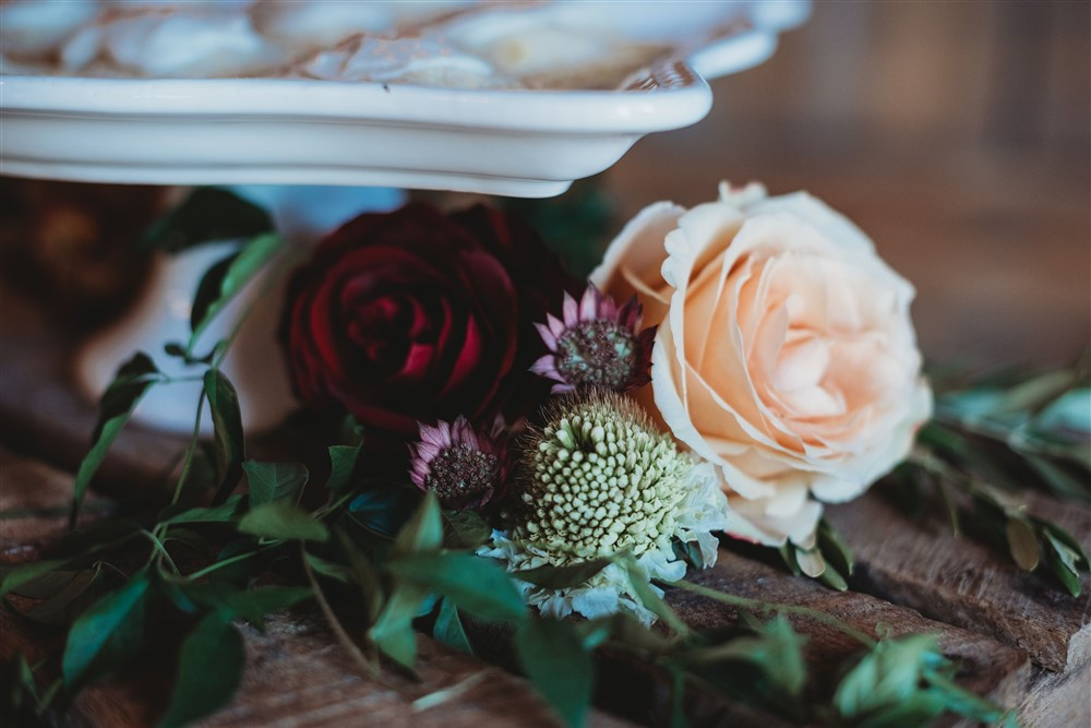 flowers decorate sweets table bringing color and texture