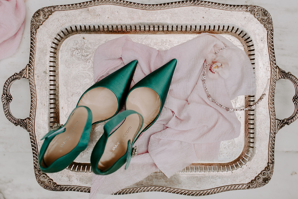 Bride's teal shoes and jewelry, styled on vintage silver tray