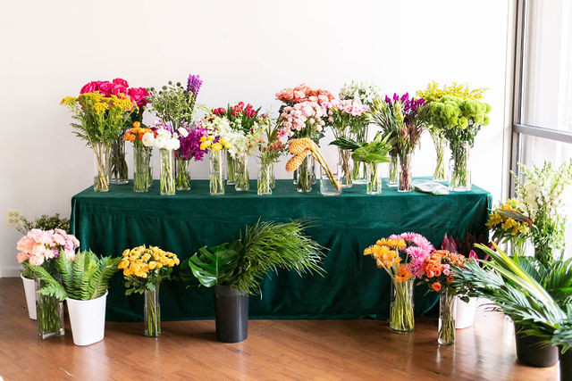 Colorful DIY Flower Bar for each guest to create their own floral bouquet to take home.