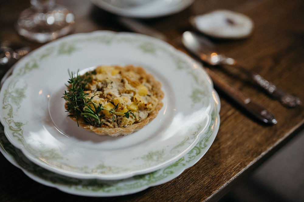 vintage china holds gourmet foods for styled shoot