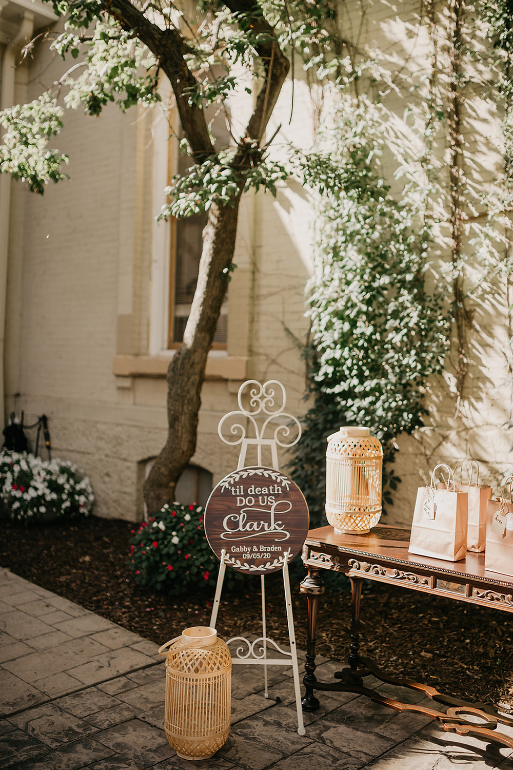 Wicker lantern decor and signage welcome guests to intimate wedding