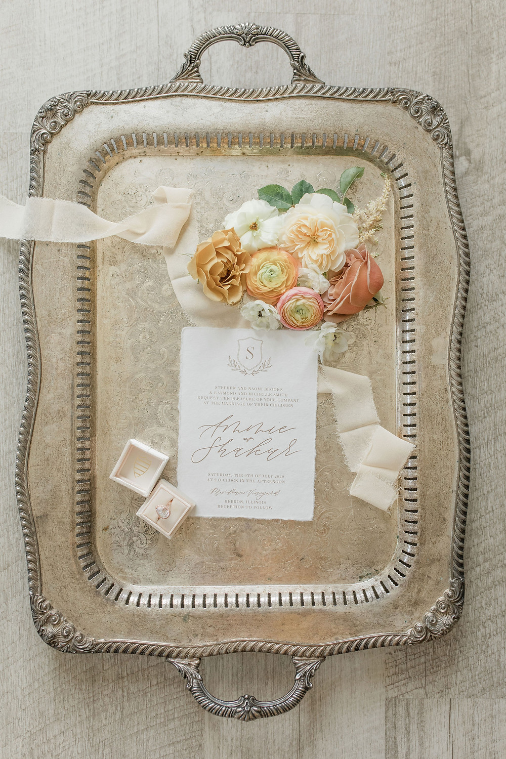 Vintage silver trays provide a great surface for details for your photographer, including flowers, ribbon, rings, and invitations!
