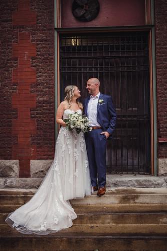 Bride-groom-posed-at-urban-building