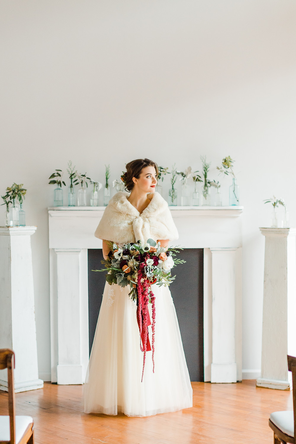 Winter whites and simple florals touched with burgundy accents. Photo Credit: Mandi Forbes Photography