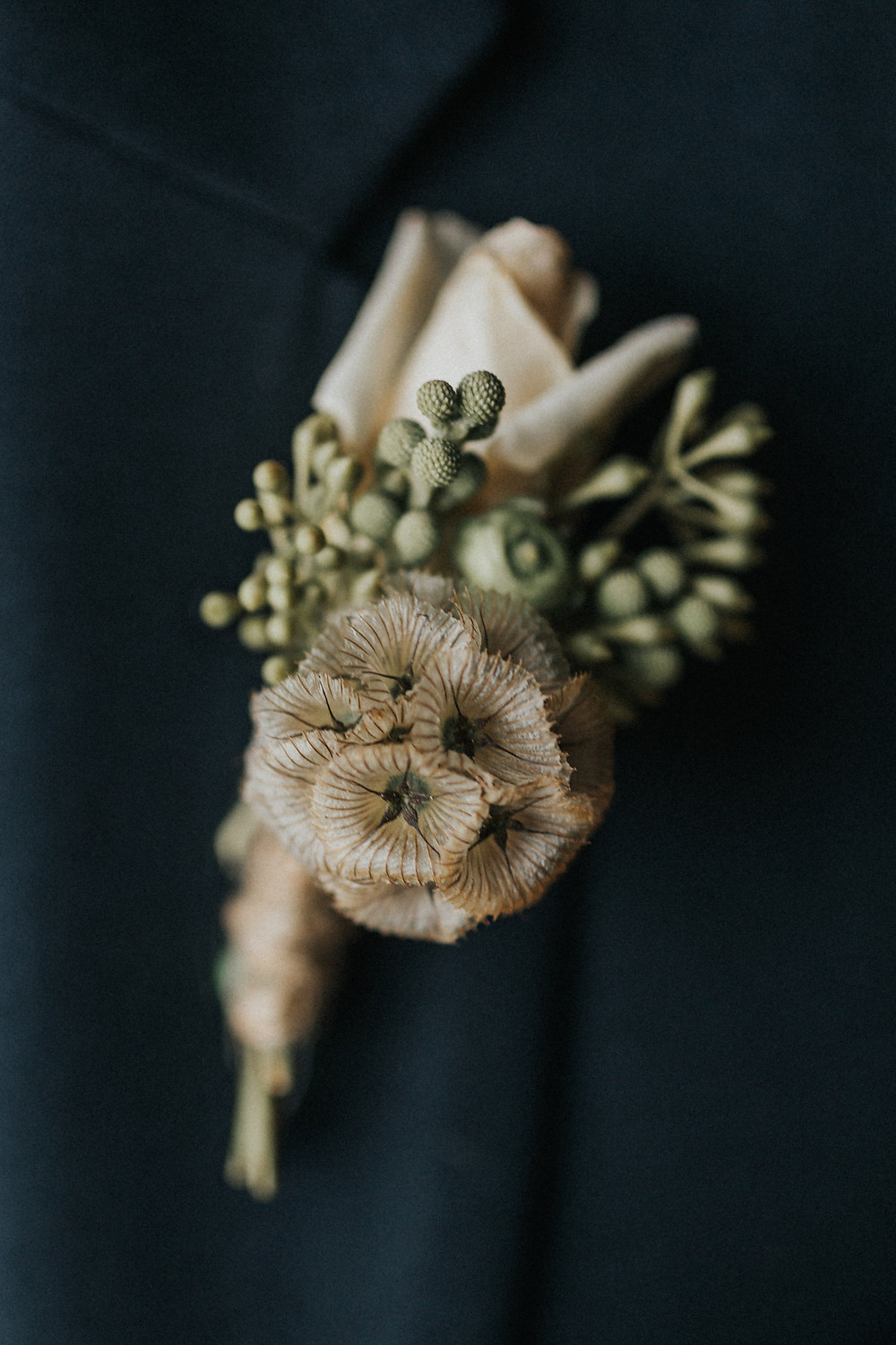Natural elements used for groom's boutonniere were stunning