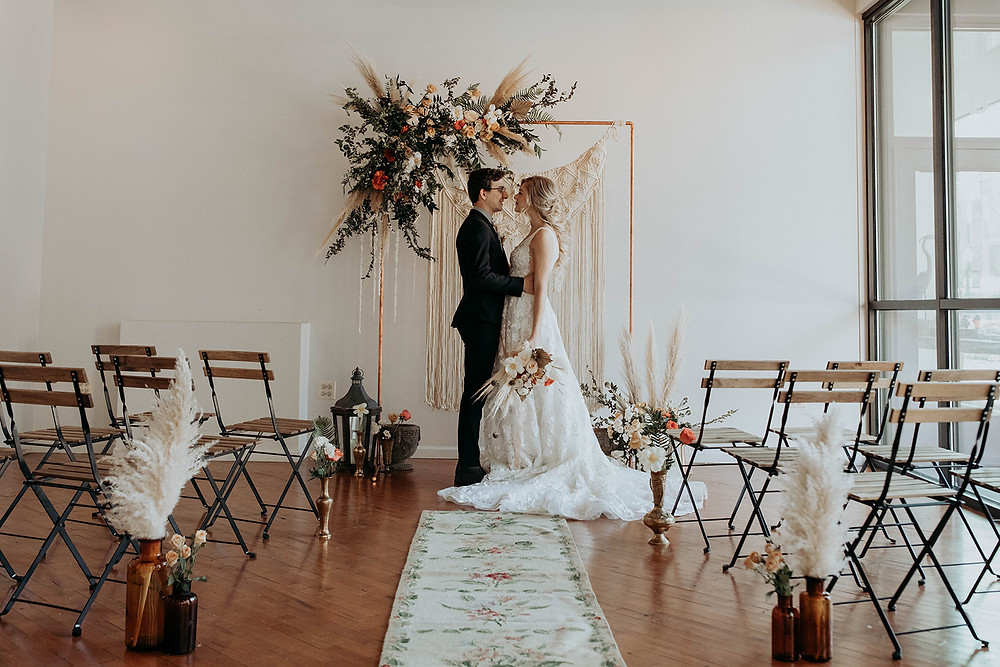 Bride and Groom post for Boho-styled intimate wedding at The Loft of Elements Preserved, Elgin, IL