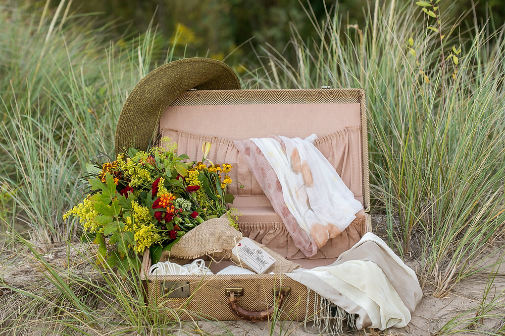Vintage suitcase holds all the beach accessories