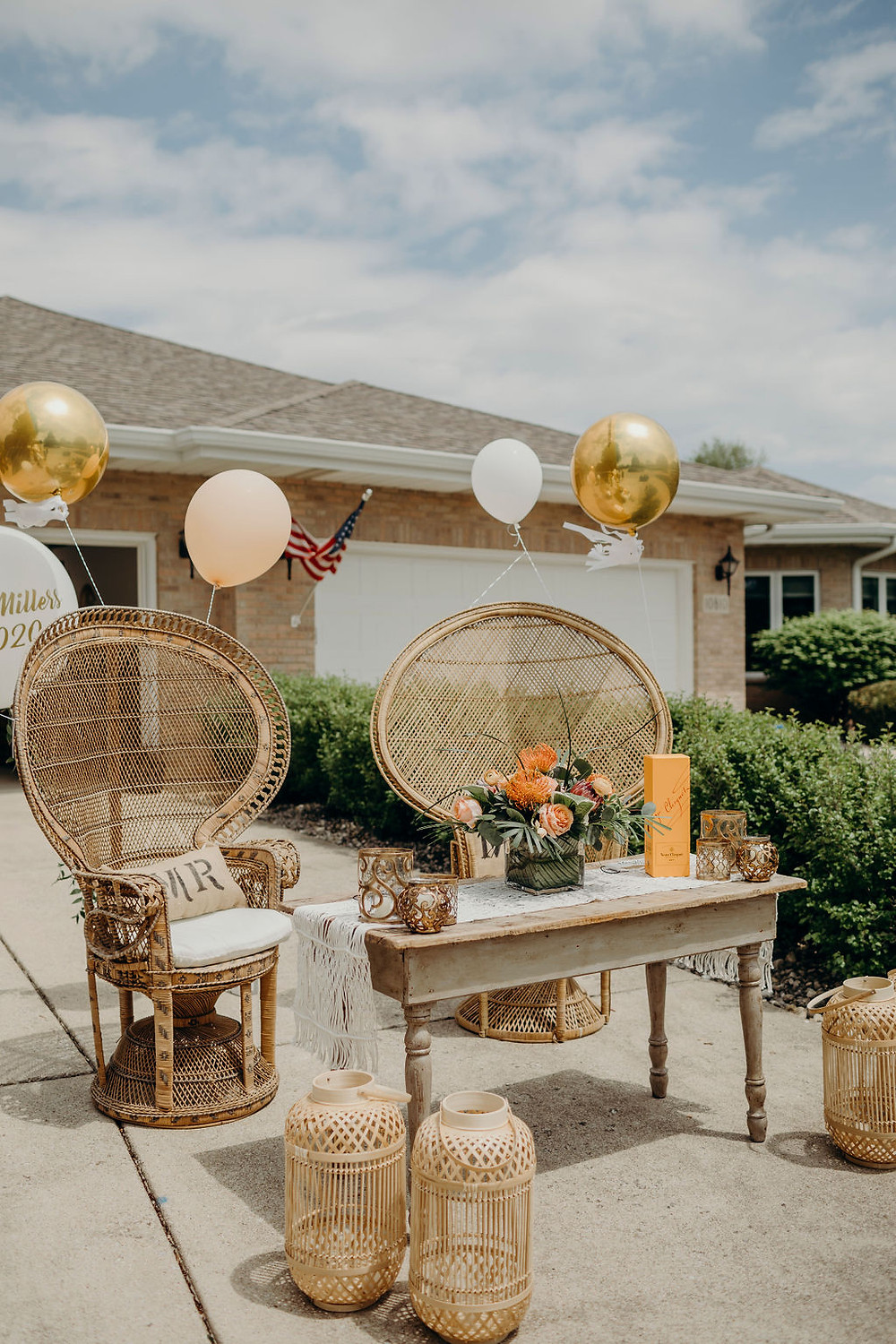 peacock chairs and sweetheart table create perfect driveway bridal shower for Chicago couple, specialty rentals from Elements Preserved Vintage Rental