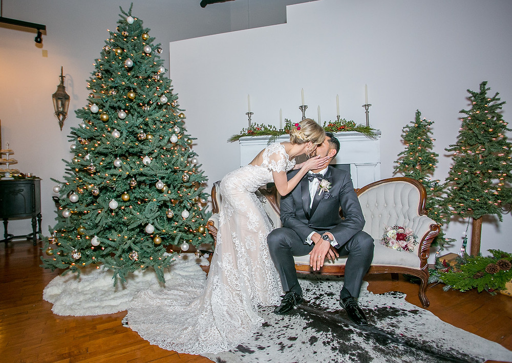 Bride and groom kiss during their wintry wedding reception at the Loft of Elements Preserved