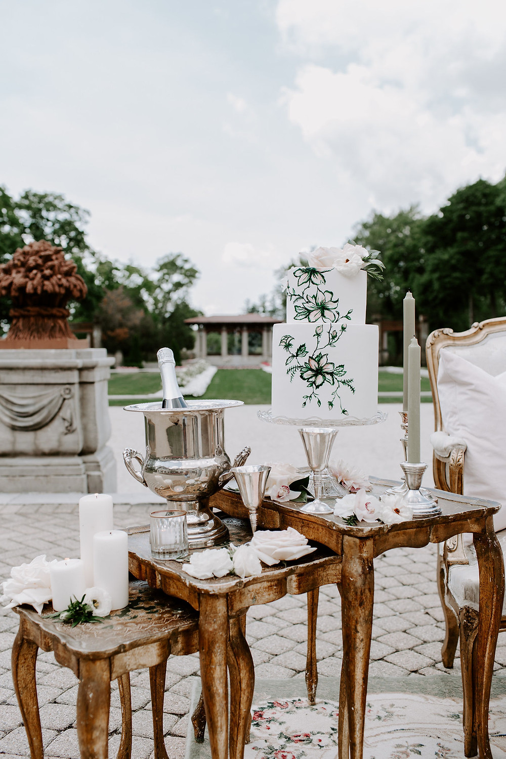 Wedding cake displayed on vintage Italian Florentine nesting tables