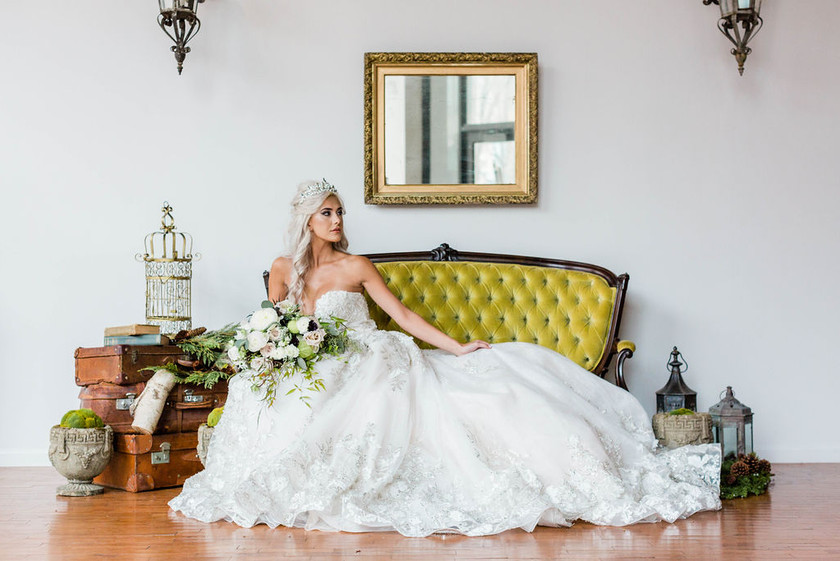 bride-poses-woodland-green-settee-vintage-outdoor-accents