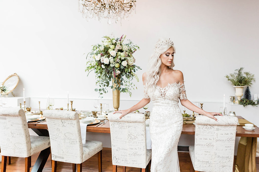 Wearing a form-fitting bridal gown, the bride looked regal as she waited for guests to be seated at the Harvest Table.