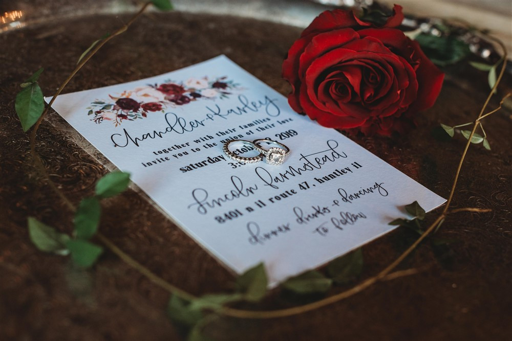 The vintage silver tray holds pieces of wedding accents; the perfect way to capture everything in one place.  Buttons, cuff links, rings, jewelry, ribbon, flowers, and invitation suite all create a beautiful flat-lay of memories!
