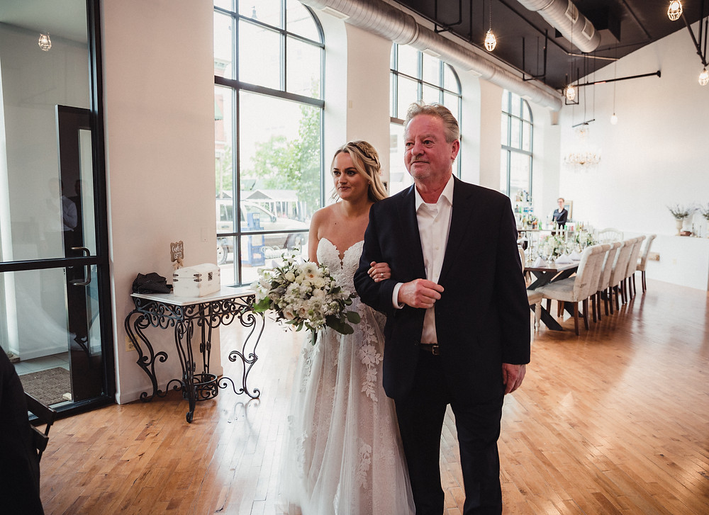 Bride walks with her father during the wedding march