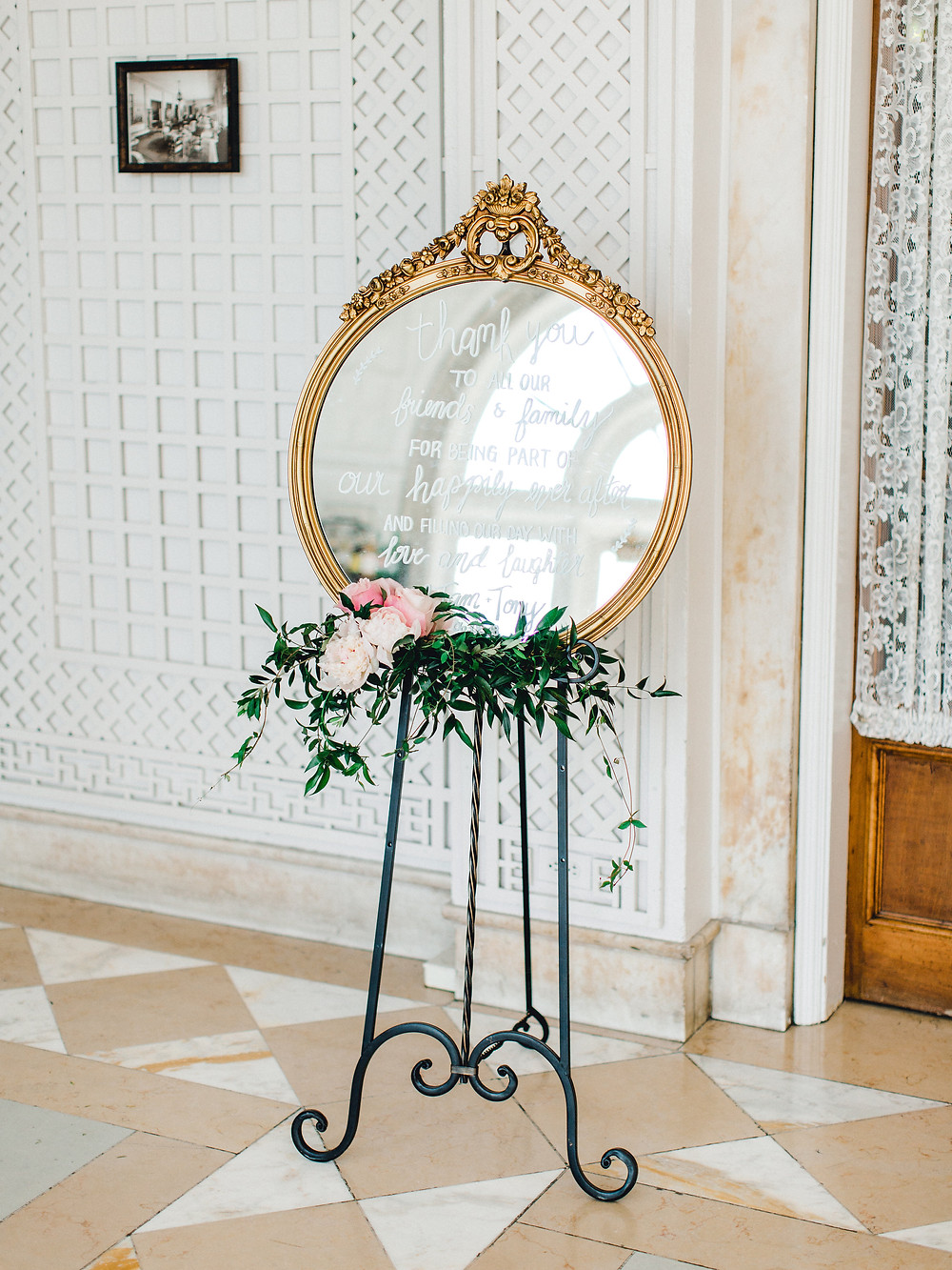 Using a vintage mirror on easel to send your guests a thank you