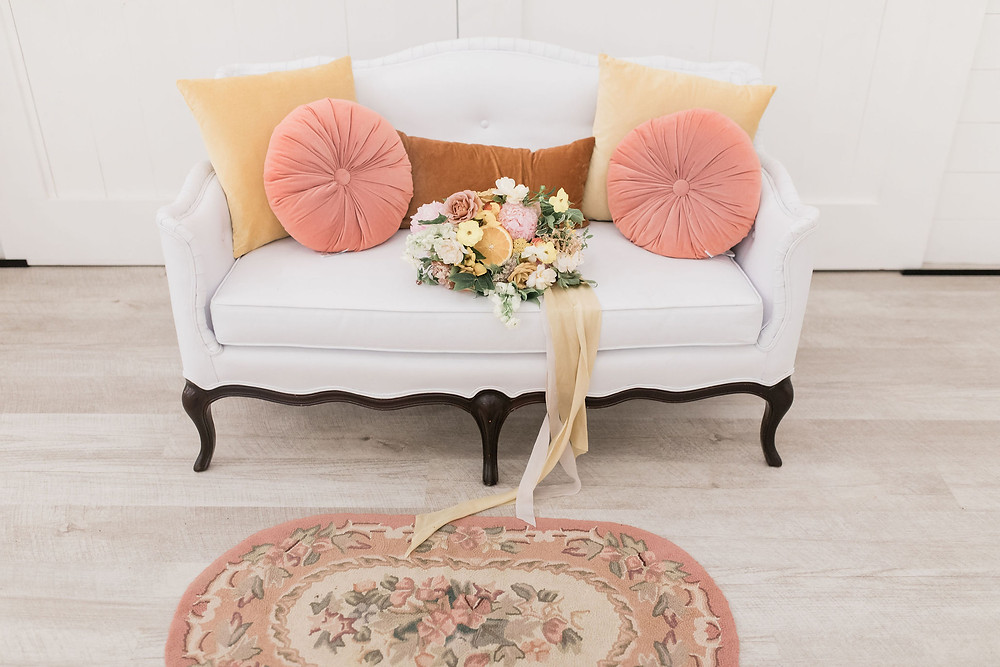 Lounge seating options; add coordinating pillows and rug and your color palette and theme continues throughout your wedding.