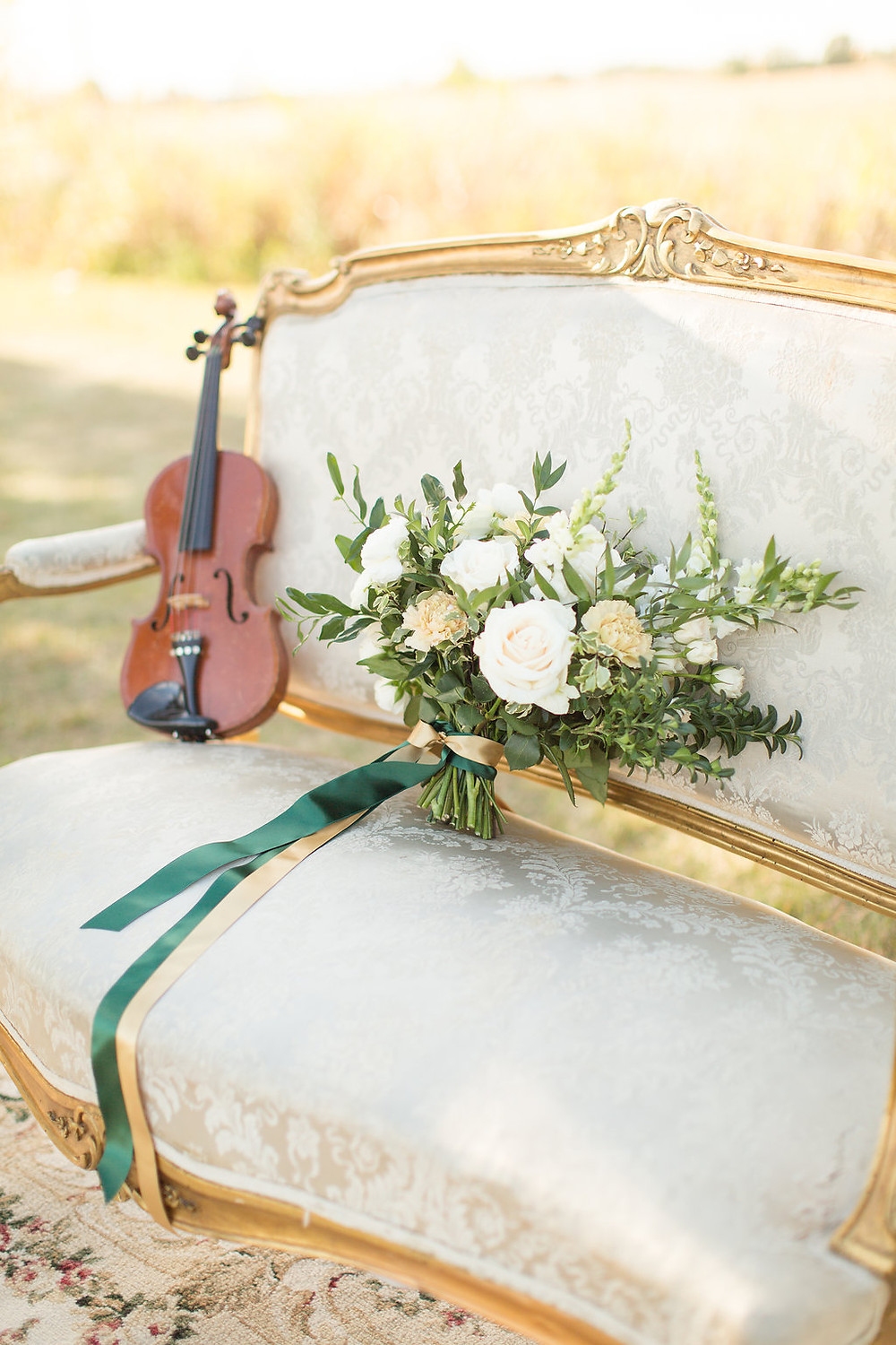 Vintage Platinum settee with floral bouquet, and violin, were perfect Celtic touches for the emerald green and gold wedding.