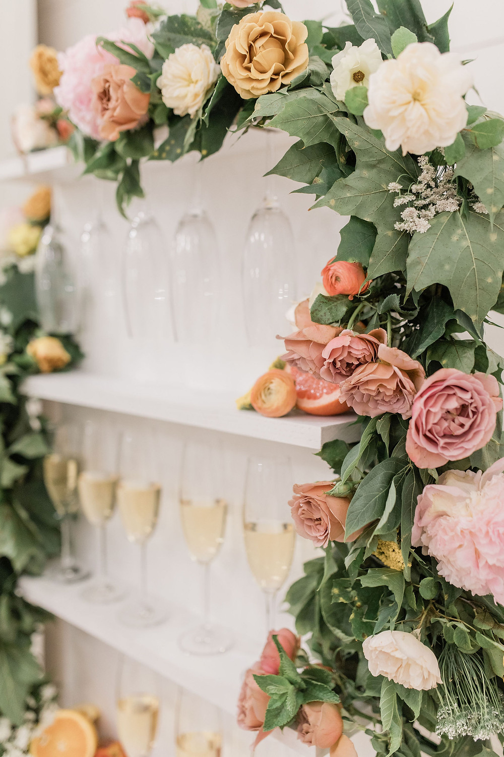 A little bubbly celebration is in store, complete with a floral garland of coordinating flowers.