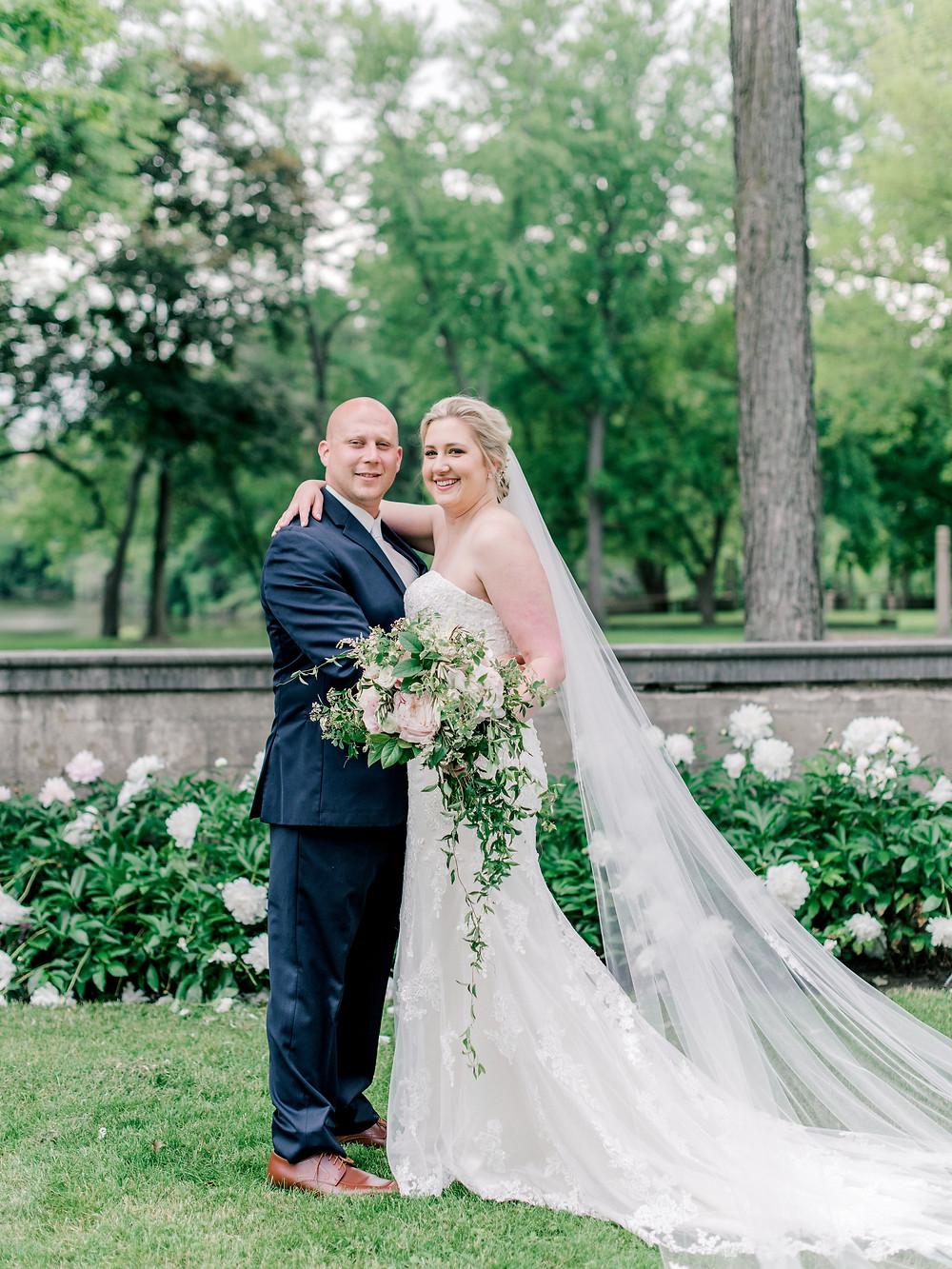 Bride and Groom seated on vintage blue settee