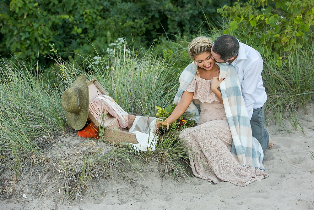 couple celebrates special times at a beautiful beach picnic