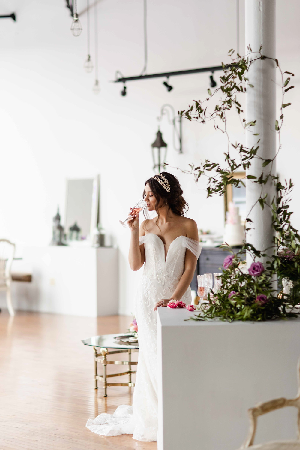 Bride sips champagne during reception at The Loft of Elements Preserved