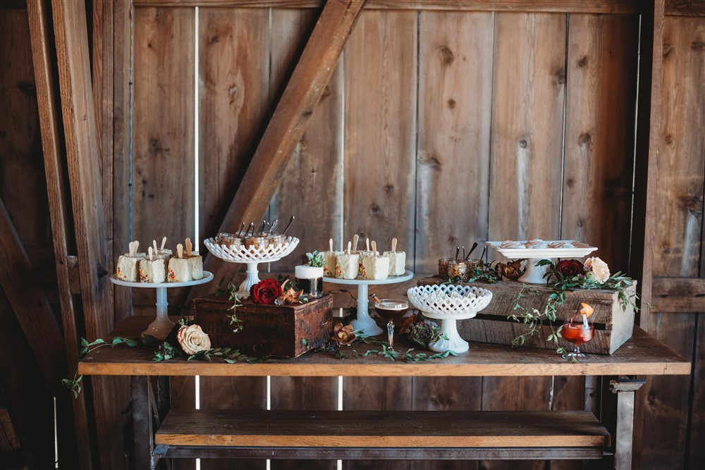 sweets table filled with pies, custards, pop tarts, and signature drinks