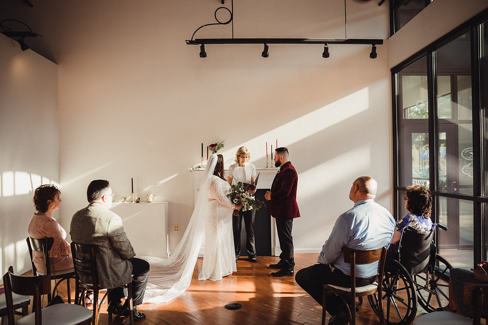 Bride and Groom with a handful of family gather for ceremony