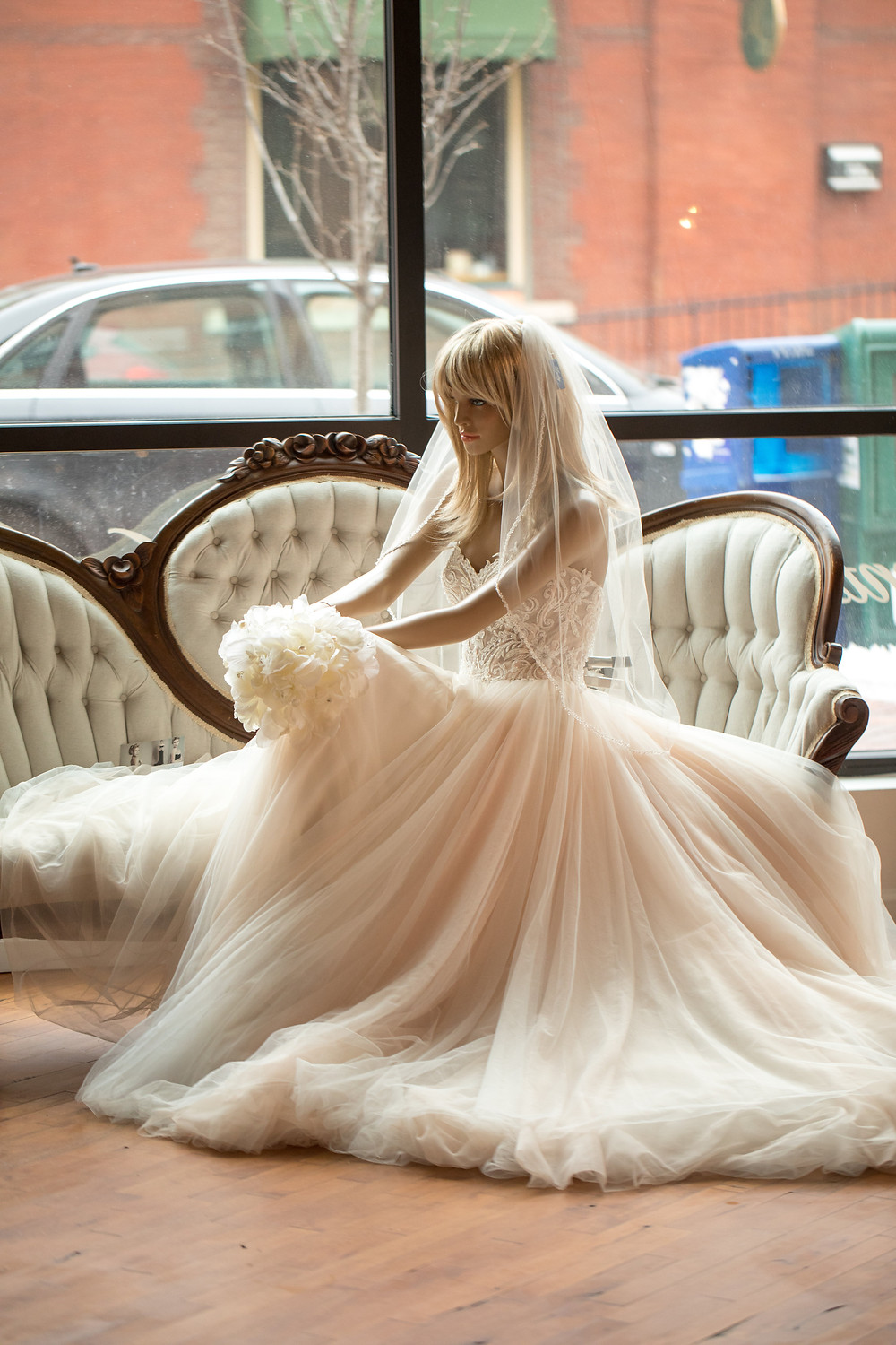 Mannequin models beautiful blush wedding dress
