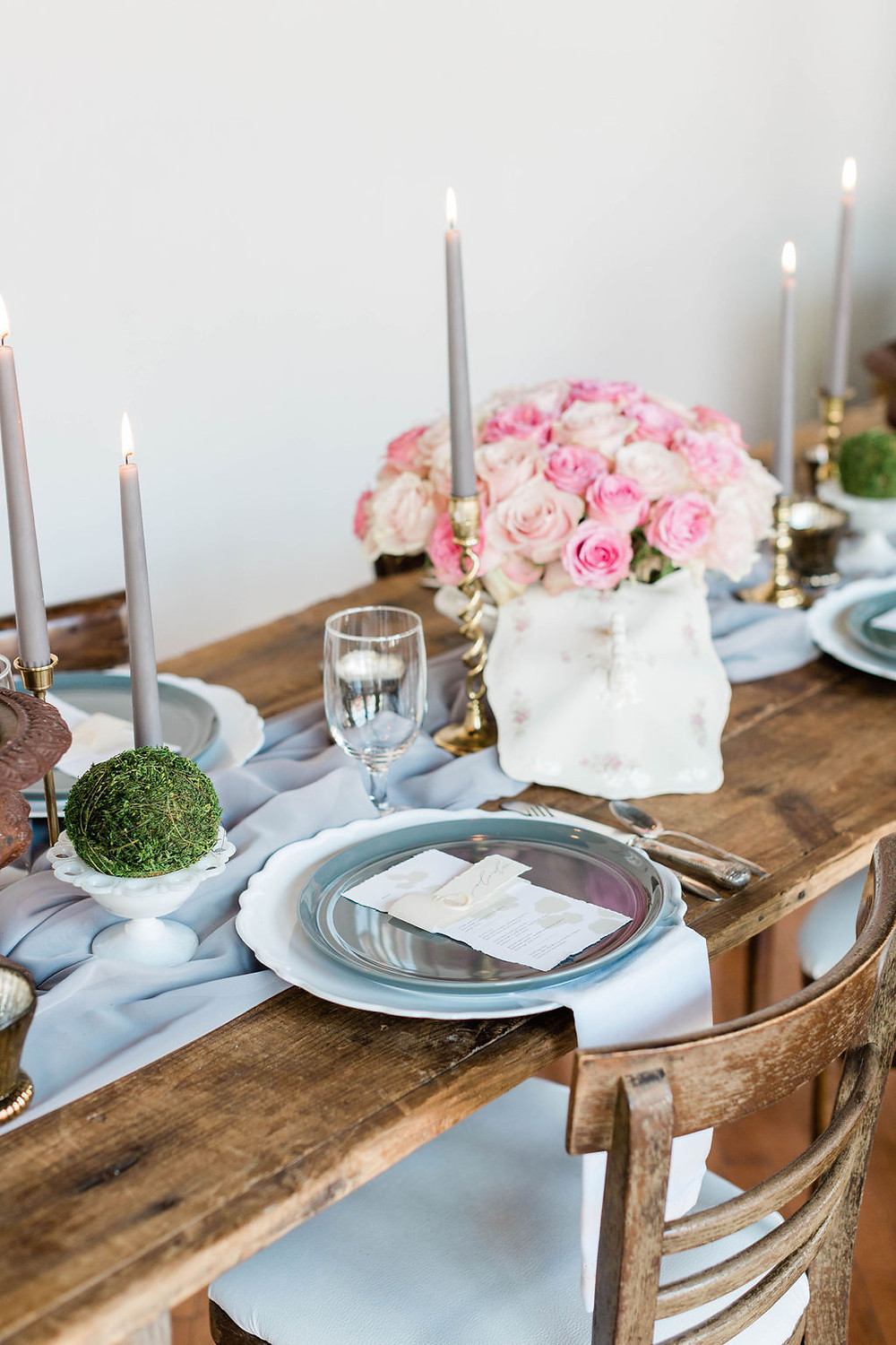 French style hand-lettering at each place setting on farm table