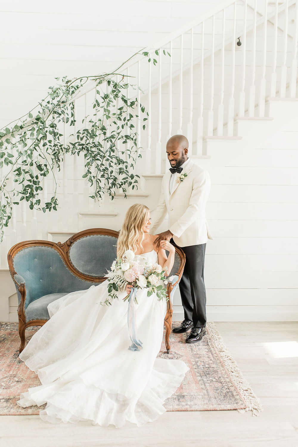Bride and Groom take a moment to enjoy each other on vintage Madeleine settee