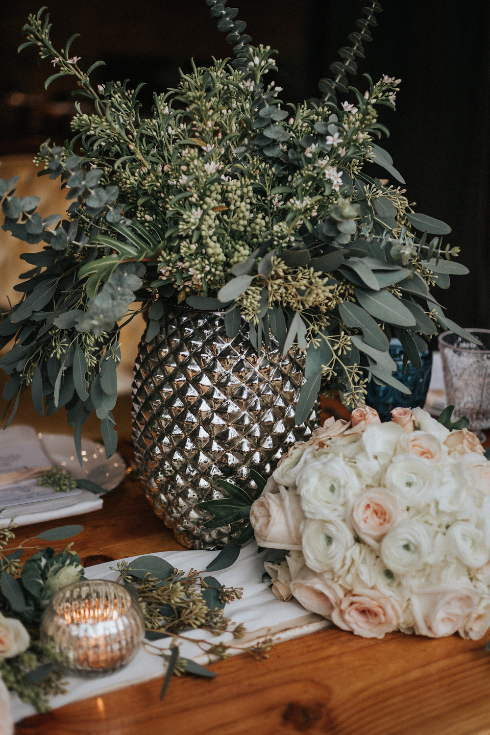 Naturally designed florals for mercury glass vase tablescape.