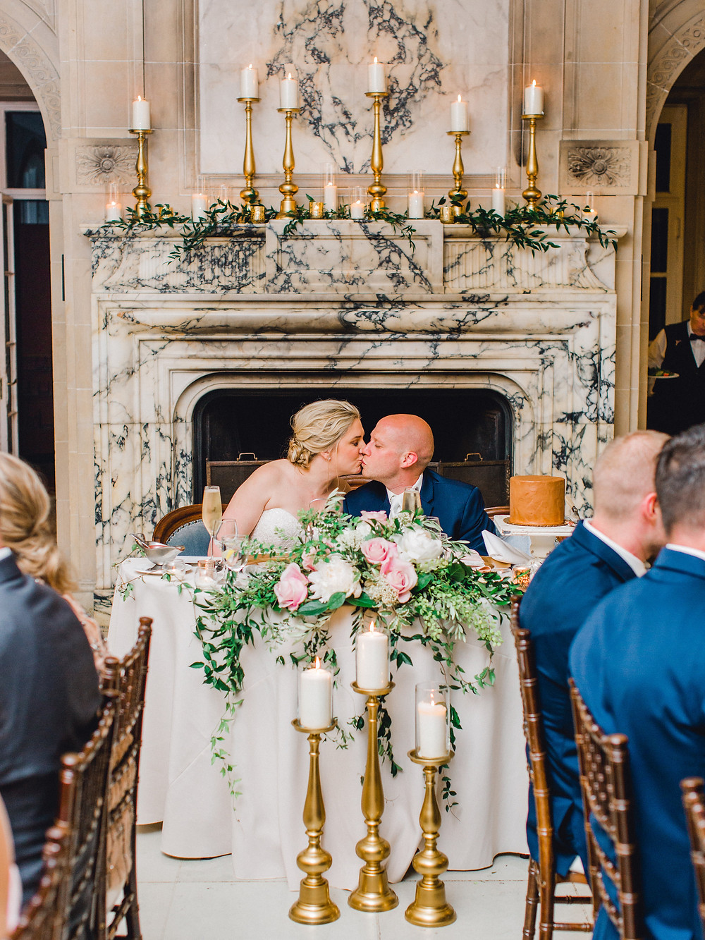 Bride and Groom exchange kiss during the dinner hour