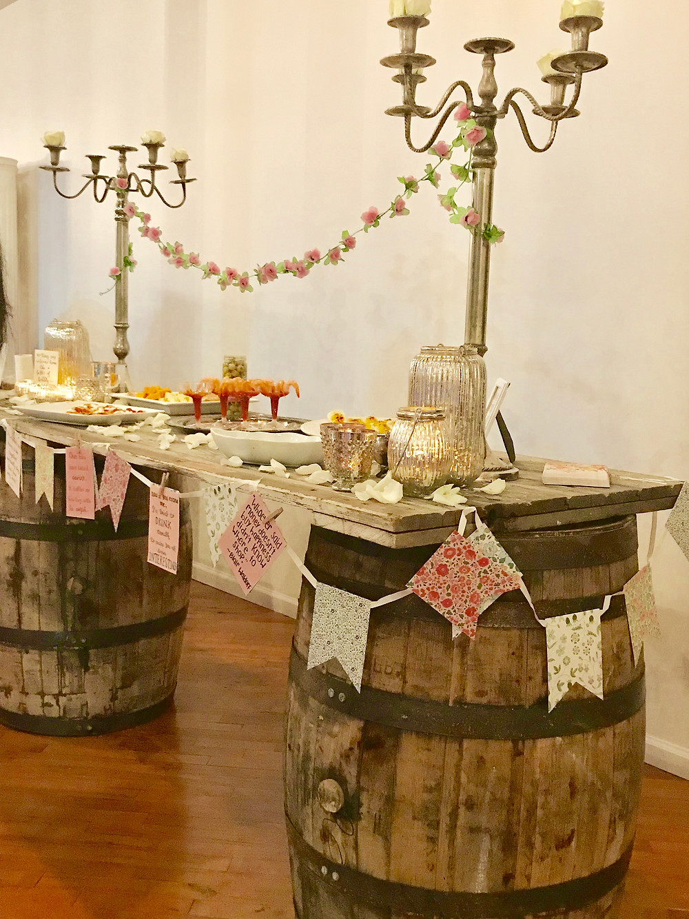 Vintage whiskey barrels and barn door create the perfect appetizer table for your event.