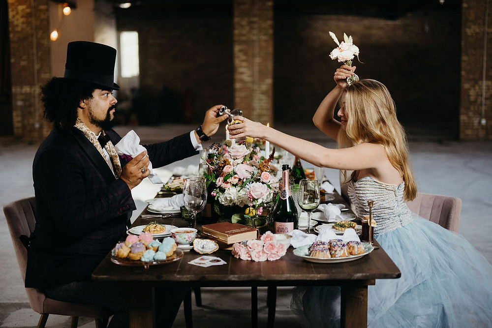 Alice and the Mad Hatter at the table