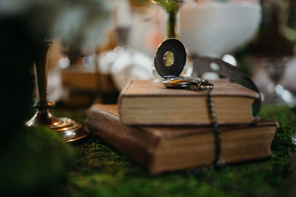 vintage books with pocket watch tablescape