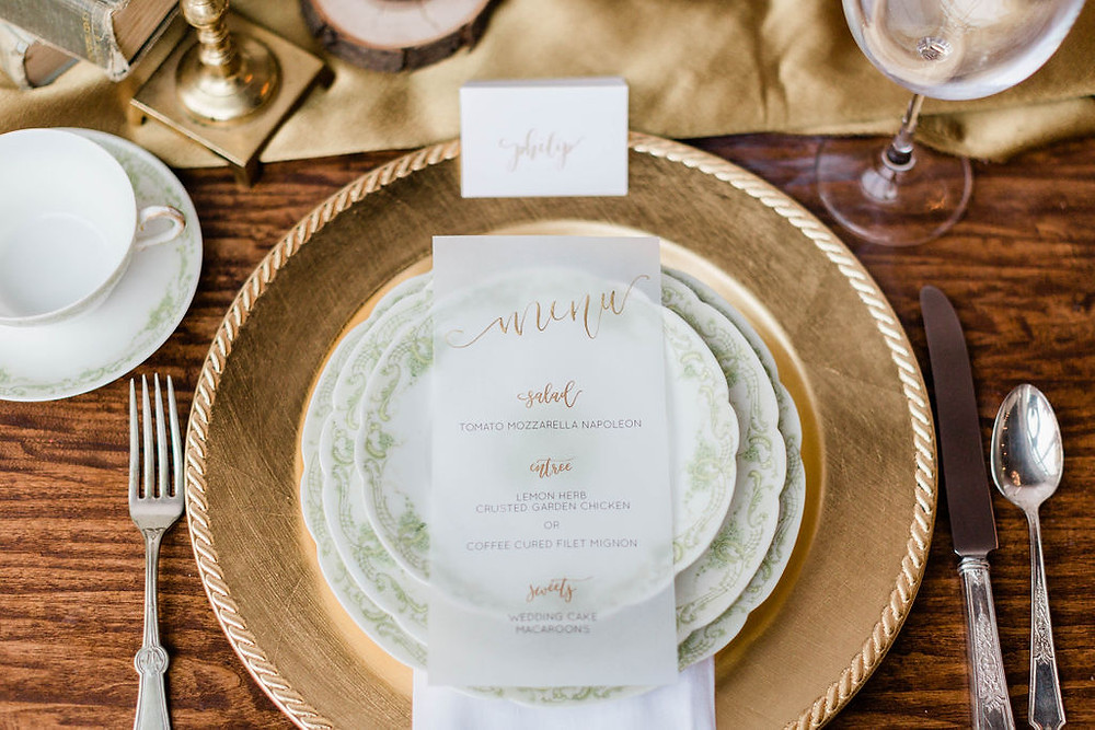 Each place was set with Haviland China place setting, vintage mis-matched flatware, linen napkin, and a calligraphy name card and menu.