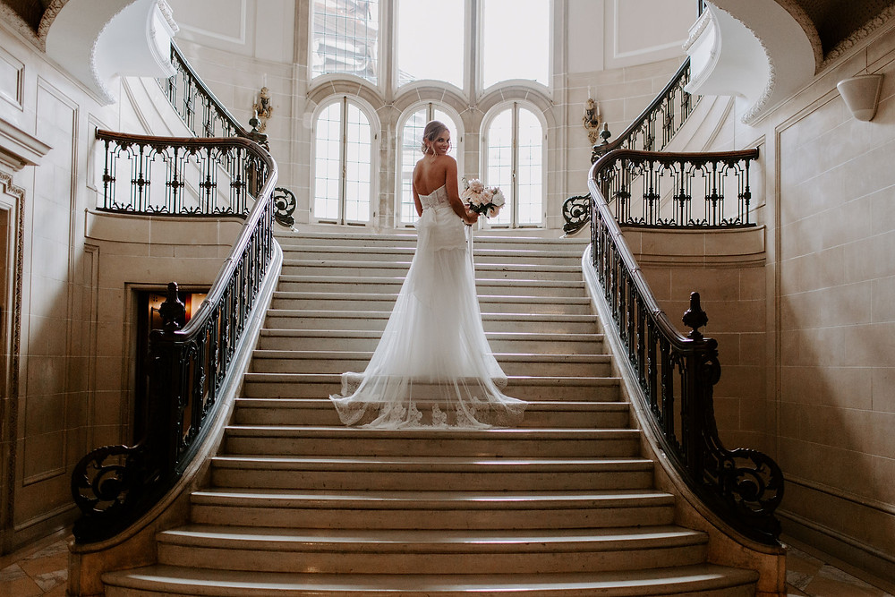 bride posing on staircase at Armour house weddings