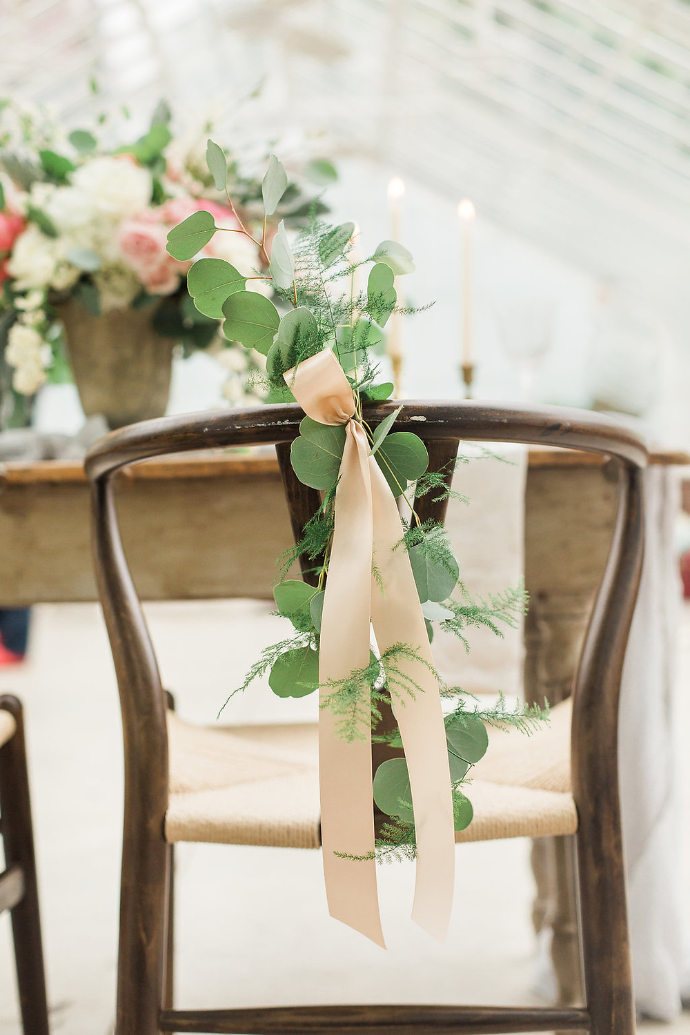 Greenhouse ceremony with farm-style sweetheart table and chairs