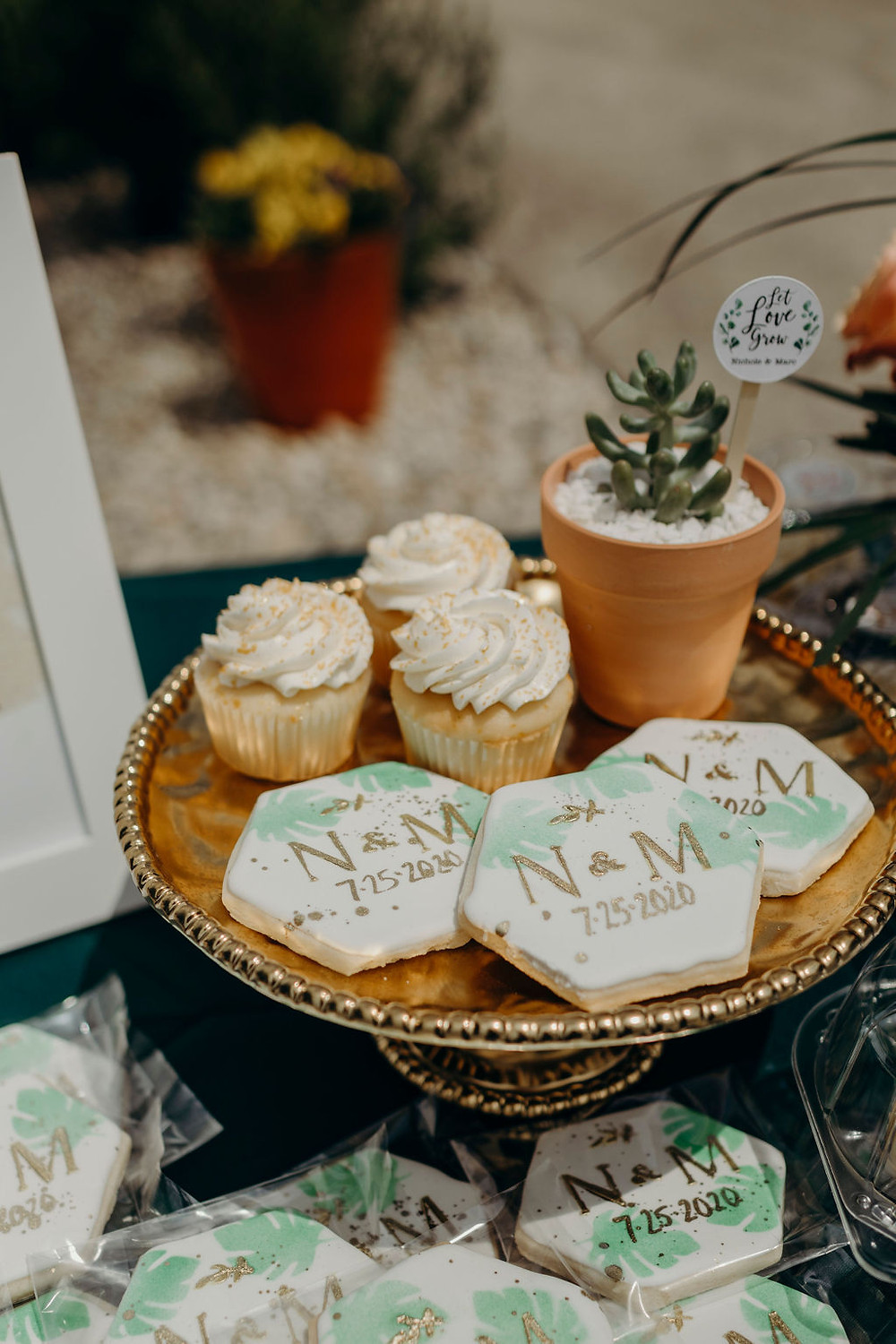 cupcakes and cookies set on gold pedestal cake plate, driveway bridal shower, boho inspired, elements preserved vintage rental