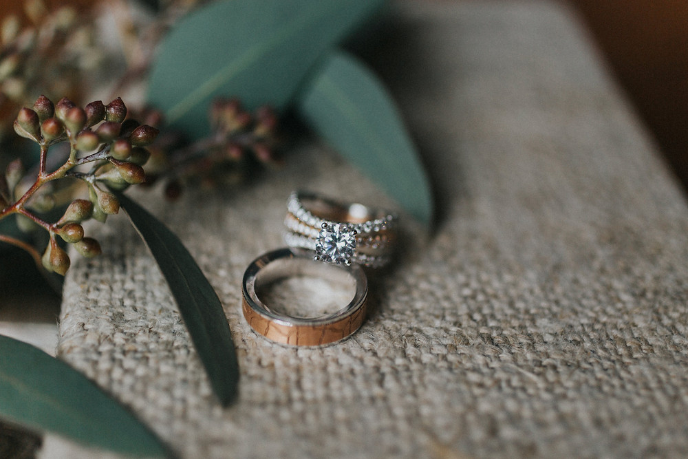 Wooden men's ring and diamond ring styled for photographs