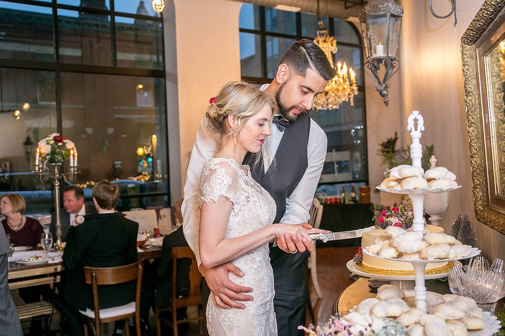 Bride and Groom cut cake at The Loft of Elements Preserved