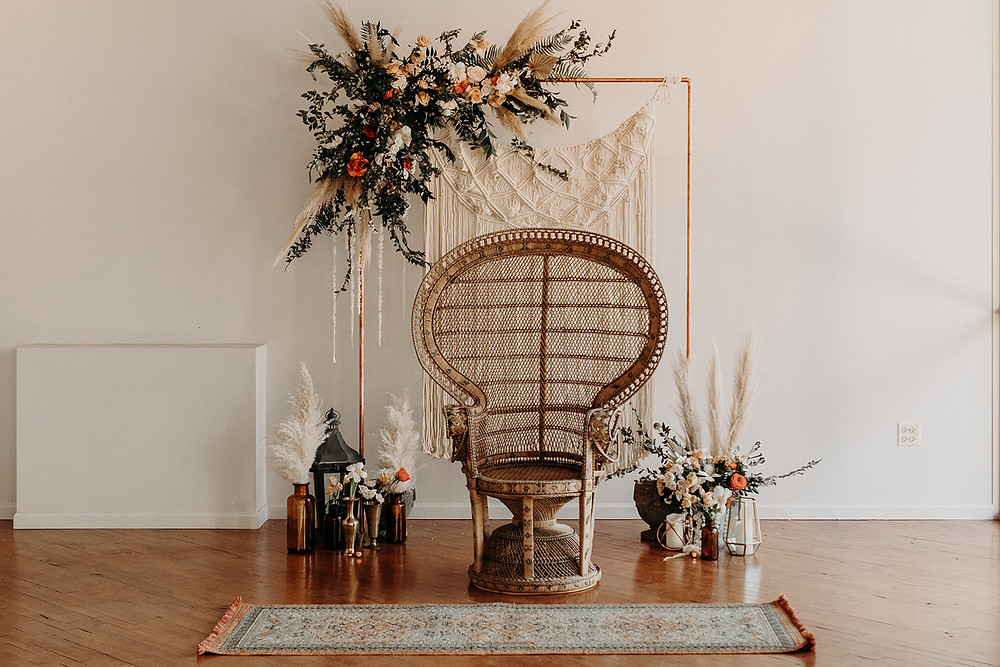 Photo opportunities with a vintage Peacock chair are perfect when you use the backdrop after the ceremony.