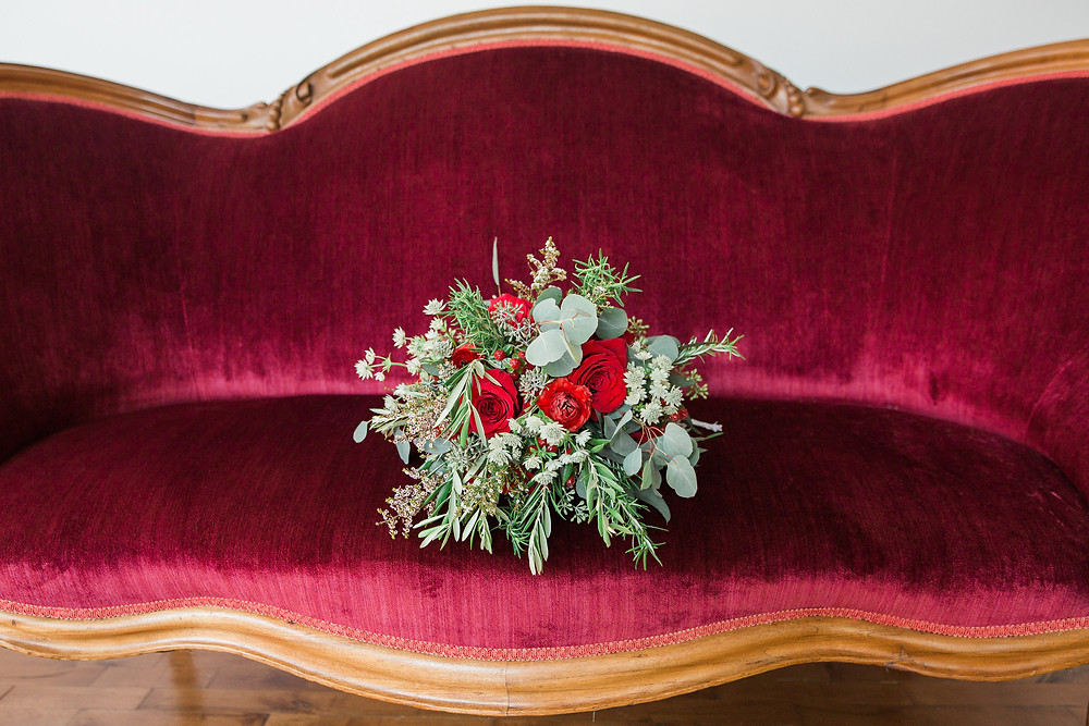 Vintage Mulberry settee with wood trim for bridal seating