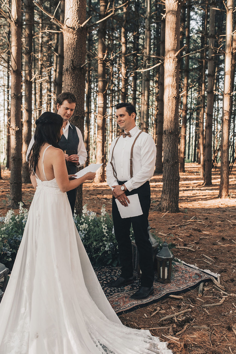 Reading vows in their woodsy, tiny elopement wedding ceremony
